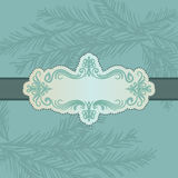 Blue card with pine branch. Vintage style blue card with label and pine branch in background Royalty Free Stock Image