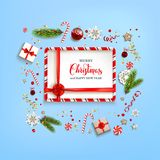 Blue card ribbon. Flat lay Christmas composition with fir tree branches on light holiday background. Top view of Natural design elements. Festive background with Stock Image