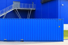 Blue cargo container. On blue building background. Cargo container at storage Stock Photography