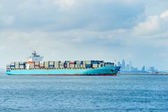 Blue cargo container ship anchored in harbor.  Royalty Free Stock Image