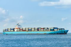 Blue cargo container ship anchored in harbor.  Stock Photography