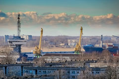 Blue cargo container ship. Moving past the Riga city Stock Photography