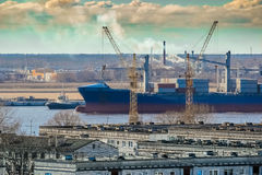 Blue cargo container ship. Moving past the Riga city Royalty Free Stock Images