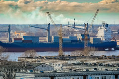 Blue cargo container ship. Moving past the Riga city Stock Images