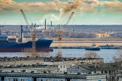 Blue cargo container ship. Moving past the Riga city Royalty Free Stock Image