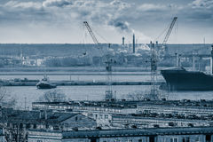 Blue cargo container ship. Moving past the Riga city Stock Photos