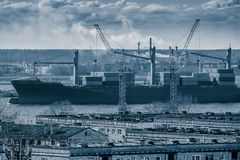 Blue cargo container ship. Moving past the Riga city Royalty Free Stock Photo