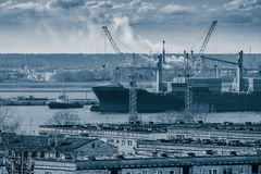 Blue cargo container ship. Moving past the Riga city Stock Photo