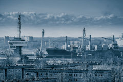 Blue cargo container ship. Moving past the Riga city Stock Image
