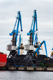 Blue cargo cranes. In the port of Riga, Europe Stock Image