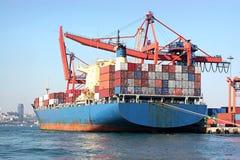 Blue cargo ship. Fully loaded, blue cargo ship Stock Image