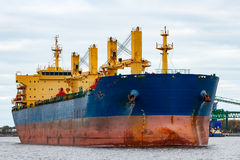 Blue cargo ship. Entering the port of Riga, Europe royalty free stock photography