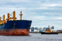 Blue cargo ship. Entering the port of Riga, Europe Royalty Free Stock Photos