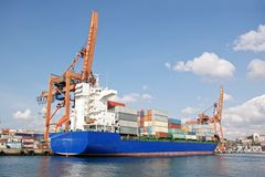 Blue cargo ship in harbor Royalty Free Stock Image
