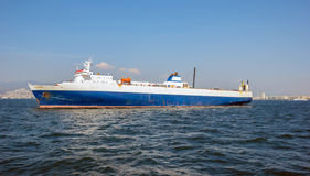 Blue cargo ship Stock Photography