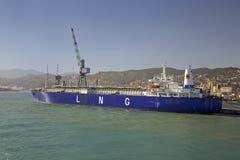 Blue cargo ship leaving harbor in Genoa Harbor, Genoa, Italy, Europe Stock Photography
