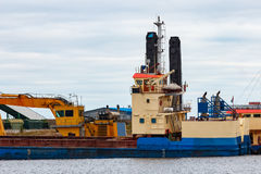 Blue cargo ship. Loading in the port of Riga, Europe royalty free stock photo