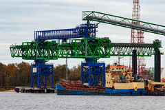 Blue cargo ship. Loading in the port of Riga, Europe stock photo