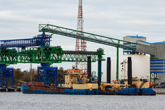 Blue cargo ship. Loading in the port of Riga, Europe stock image