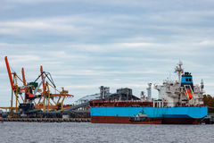 Blue cargo ship. Loading in the port of Riga, Europe stock images