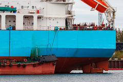 Blue cargo ship. Loading in the port of Riga, Europe royalty free stock photography