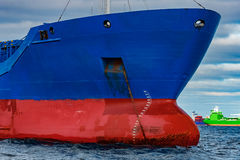 Blue cargo ship. Moored in still Baltic sea water stock photography