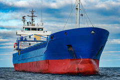 Blue cargo ship moored Stock Photos