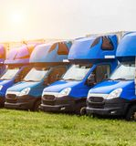 Blue cargo vans stand in a row, trucking and logistics, trucking industry royalty free stock photo