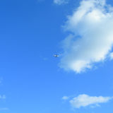 Blue Caribbean sky with airliner Stock Photos