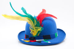 Blue carnival bowler with colorful feathers Royalty Free Stock Photography