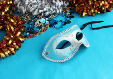 Blue carnival mask on a blue background with festive decorations. Stock Images