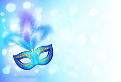 Blue carnival mask with feathers on bokeh lights Stock Photography