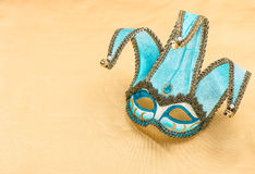Blue carnival mask harlequin. Holidays background Stock Photos