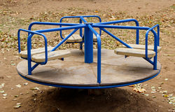 A blue carousel on a playground Stock Photography
