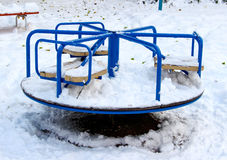 A blue carousel on a playground in winter Stock Photography