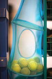 Blue carry bag with tennis balls Royalty Free Stock Images