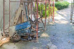 The blue cart  falls on its side. At construction area Stock Image