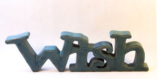 Blue Carved Wooden Wish Sign Royalty Free Stock Photos