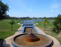Blue cascaded fountain in a park Royalty Free Stock Image