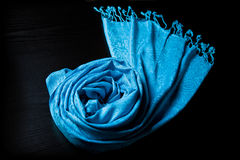 Blue cashmere scarf on a black background Stock Photography