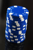 Blue casino chips on  black background Royalty Free Stock Image