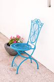 Blue cast iron cafe style chair Royalty Free Stock Photo