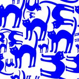 Blue cats pattern isolated on white background Stock Images