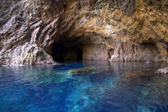 A blue cave in the mediterranean sea Stock Images