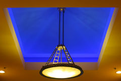 Blue ceiling lighting treatment. Contemporary entry way high-end ceiling lighting installation stock photo