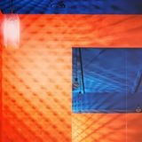 Blue Ceiling and Orange Wall With Mirror. Part of corner in colorful orange and blue interior with angle view to the ceiling reflected in the mirror on the wall Royalty Free Stock Photo