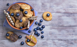 Blue ceramic bowl with cookies stock photos