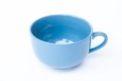Blue ceramic bowl on white background Royalty Free Stock Image