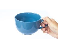 Blue ceramic bowl on white background Royalty Free Stock Photos