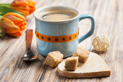 Blue ceramic cup of black hot coffee with brown sugar Royalty Free Stock Photos